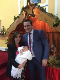 Noel Gerard Kelly with his parents Helen and Kevin, on his baptism day, 27 December, 2015.
